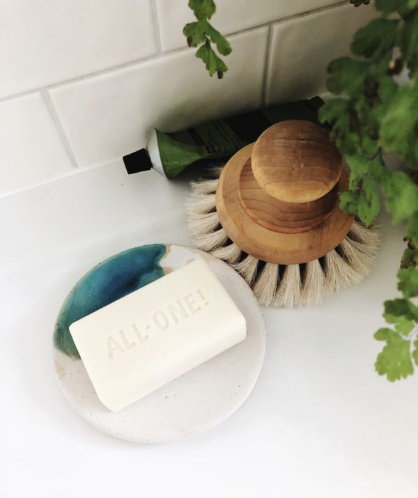 handmade pottery soap dish with a unique turquoise and white glaze