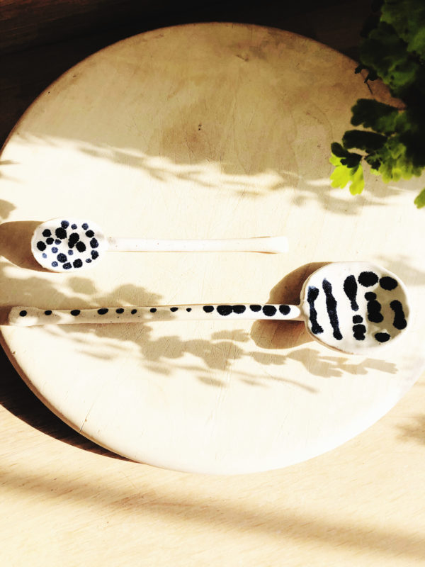Small handmade pottery spoon with dotty design