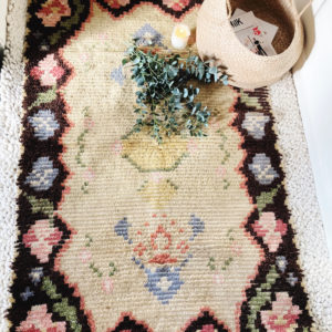 vintage Swedish rya rug with dark border and floral pattern