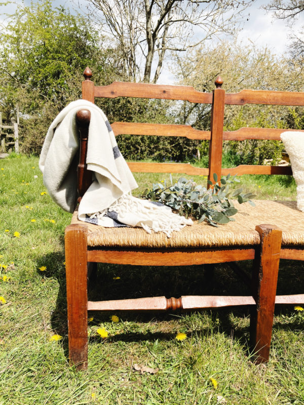 19th century French ladder back bench with rush seat